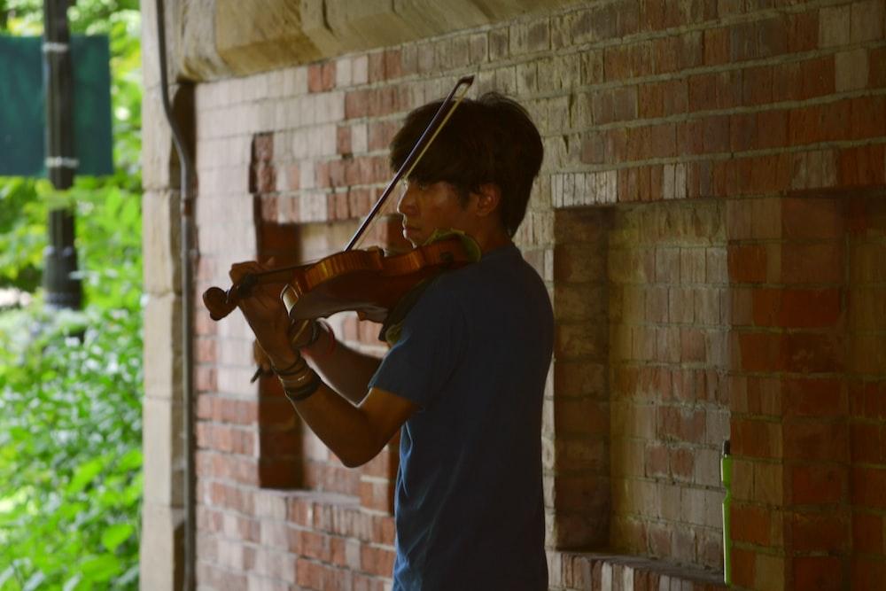 man using violin