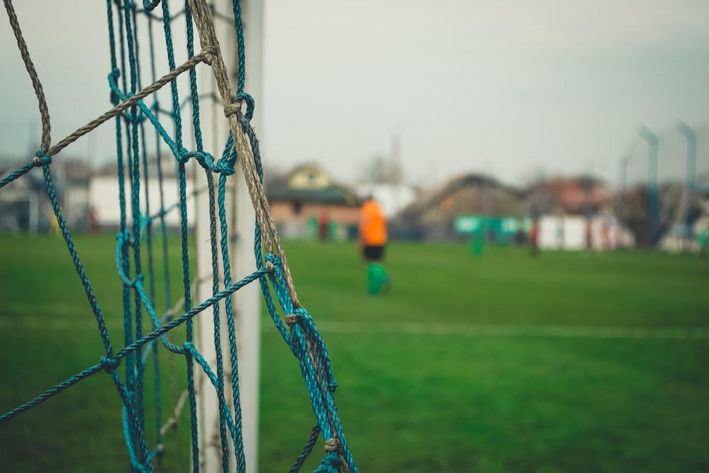 closeup photography of goalpost during daytime