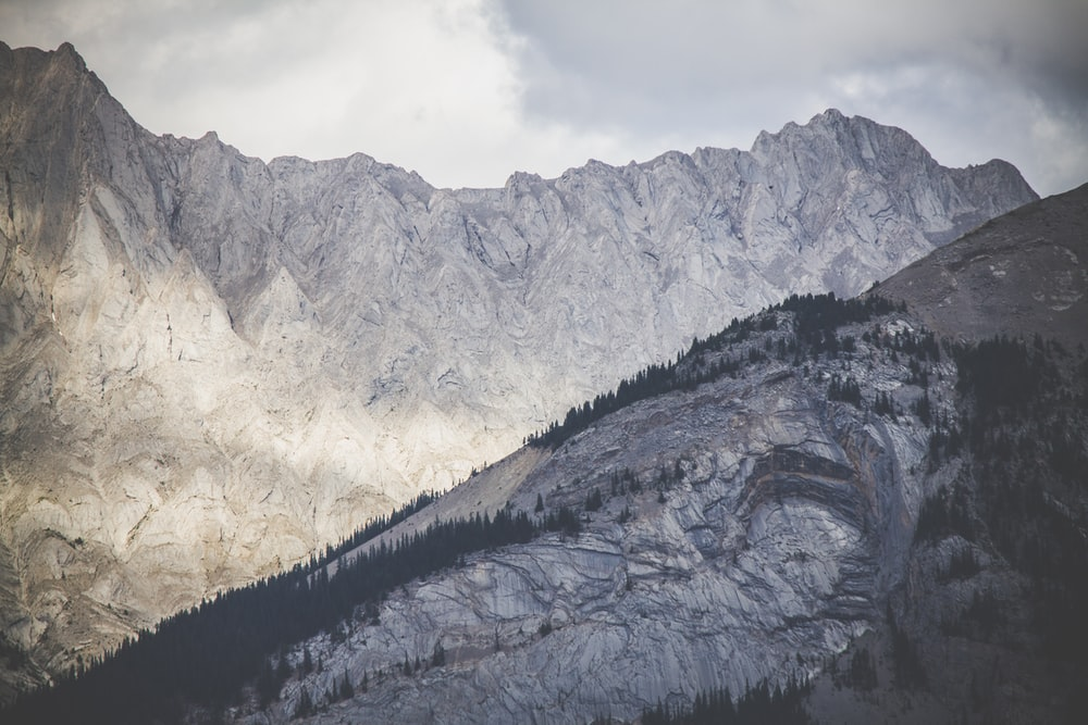 gray mountains under gray sky during daytime