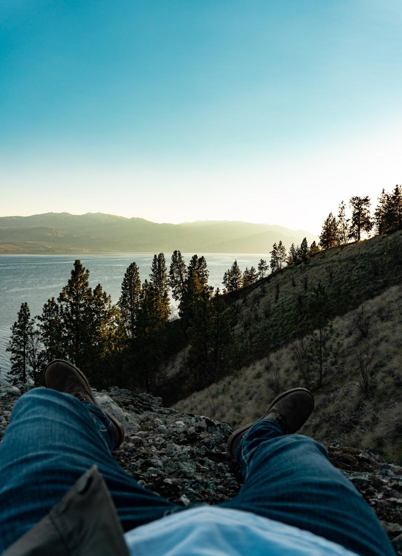 man taking photo of sea