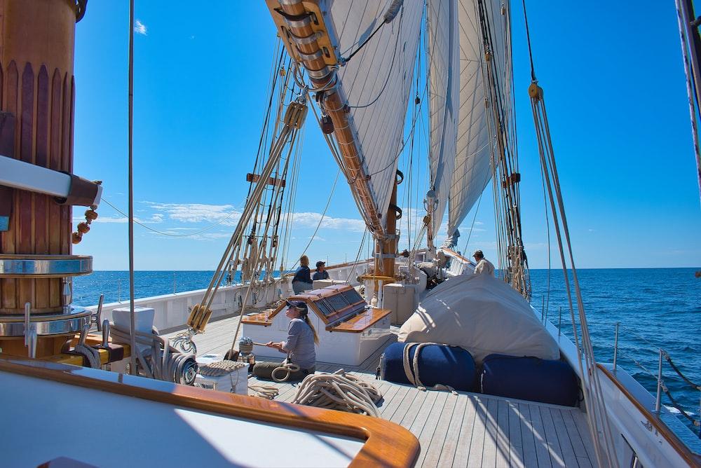 white boat sail at daytime