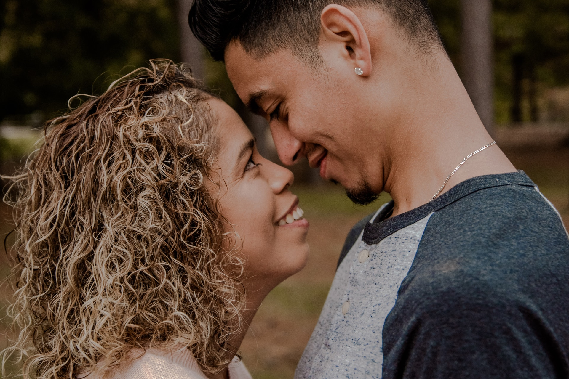 couple standing face to face closely to each other