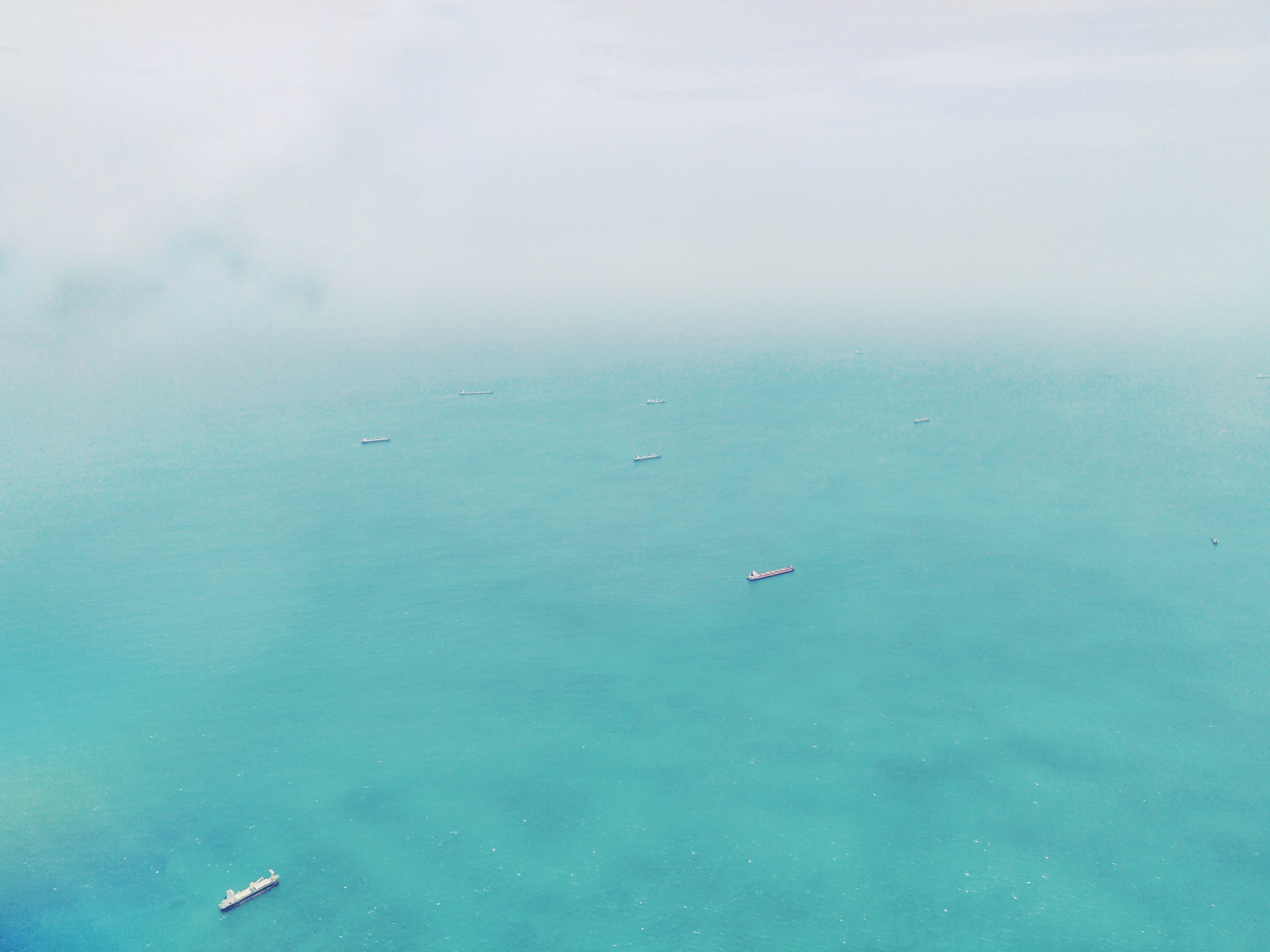 aerial photography of ships on ocean