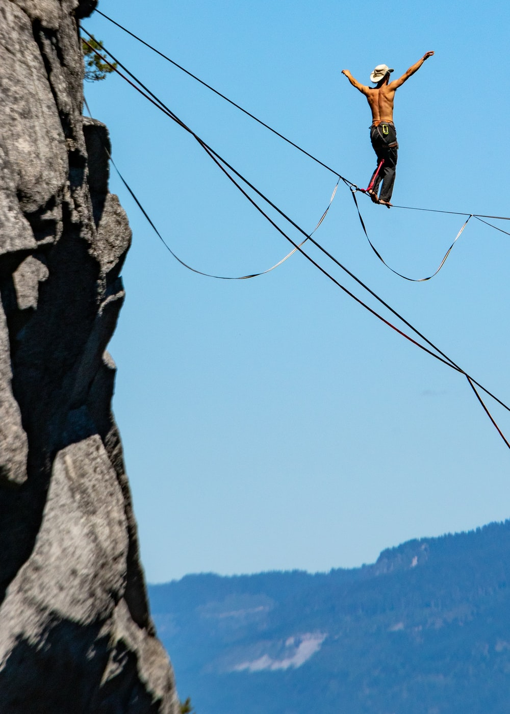 man standing on ropes