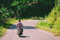 A man riding a bike in mountains