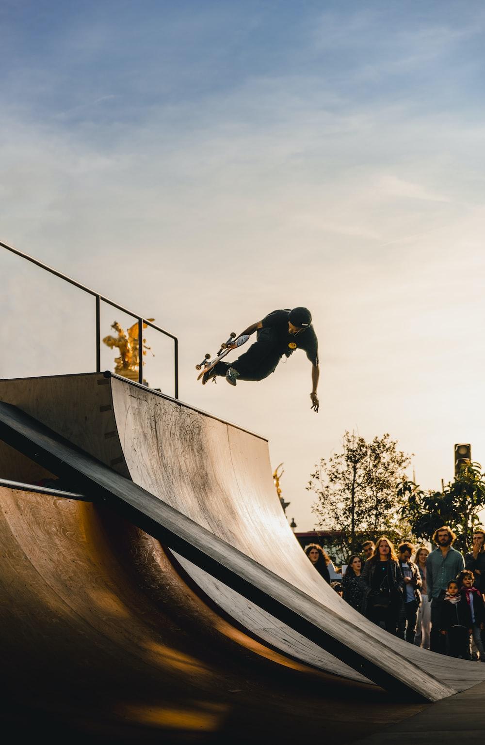 people watching man skateboarding at the ramp