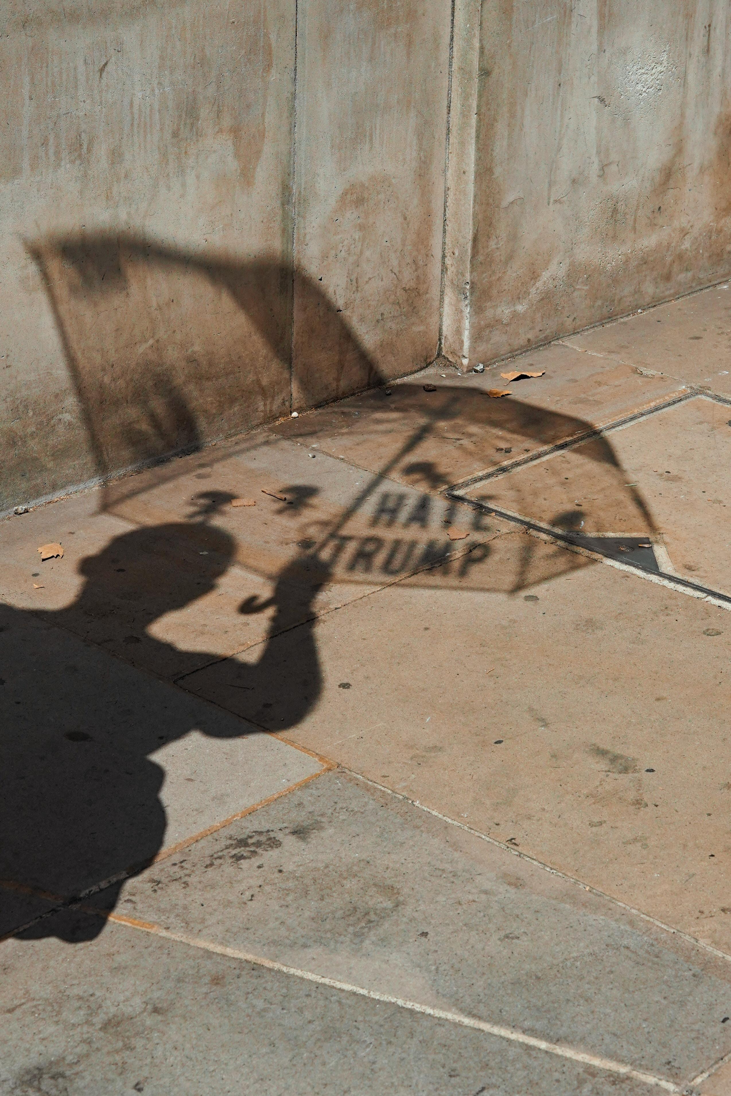 man holding umbrella silhouette