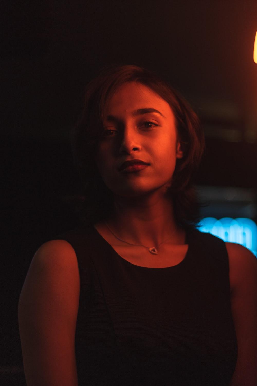 woman in black tank top near yellow light
