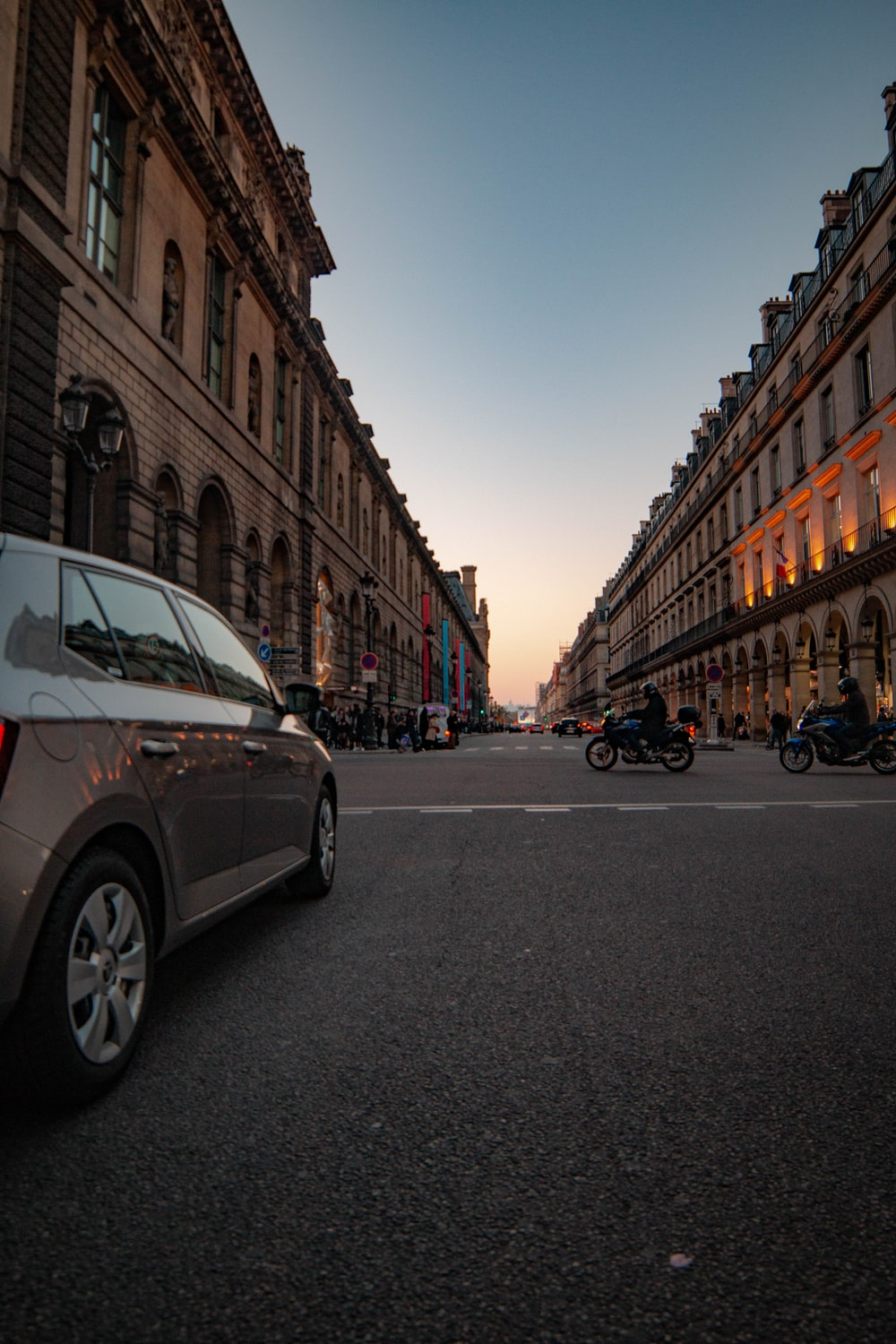 silver vehicle in road during golden hour