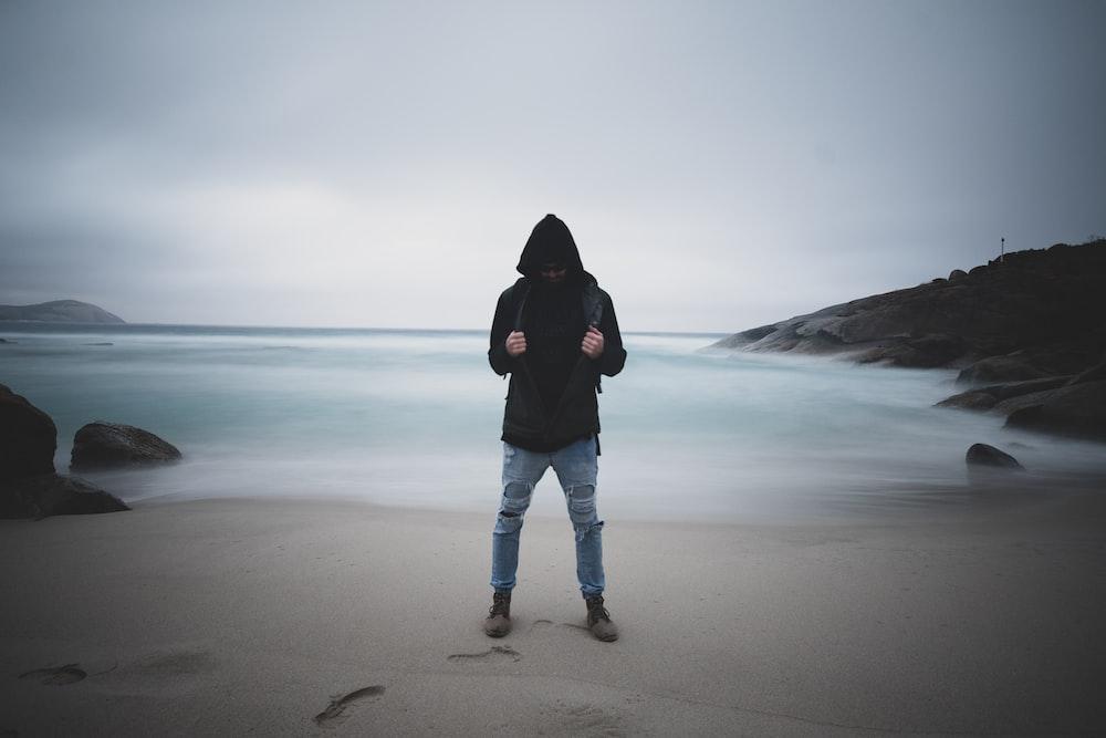 man standing on seashore