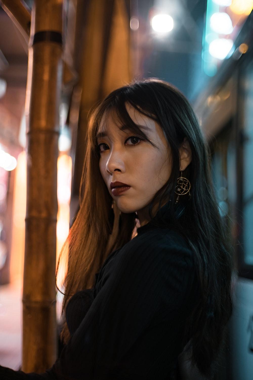 portrait of woman wearing black top