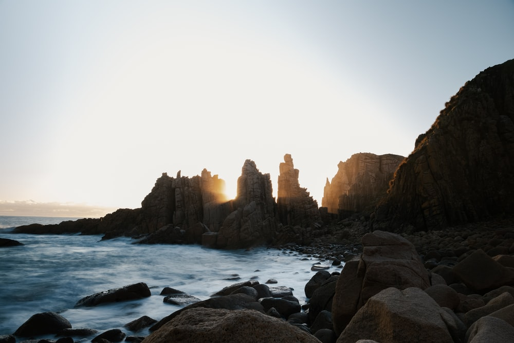stone formations on ocean during daytime