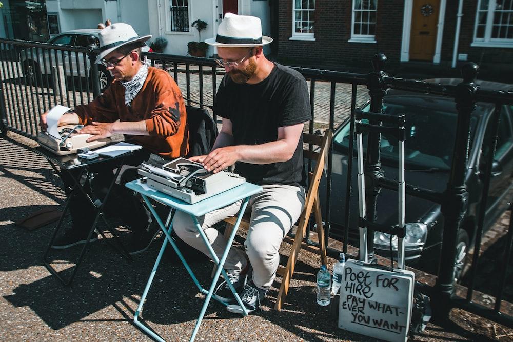 two men typewriting