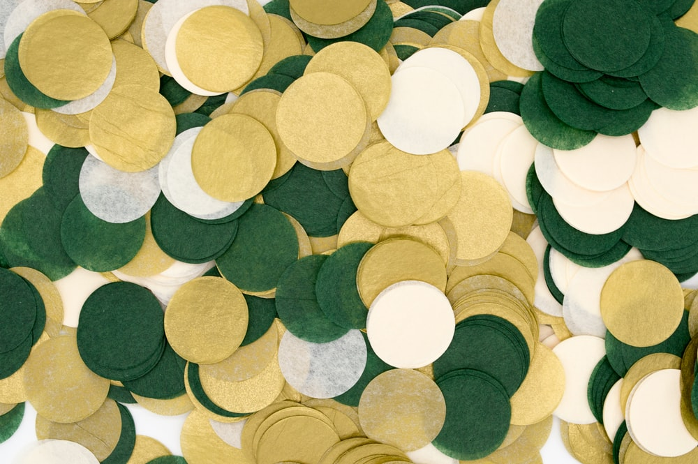 round brown, green, and white ornament lot illustration