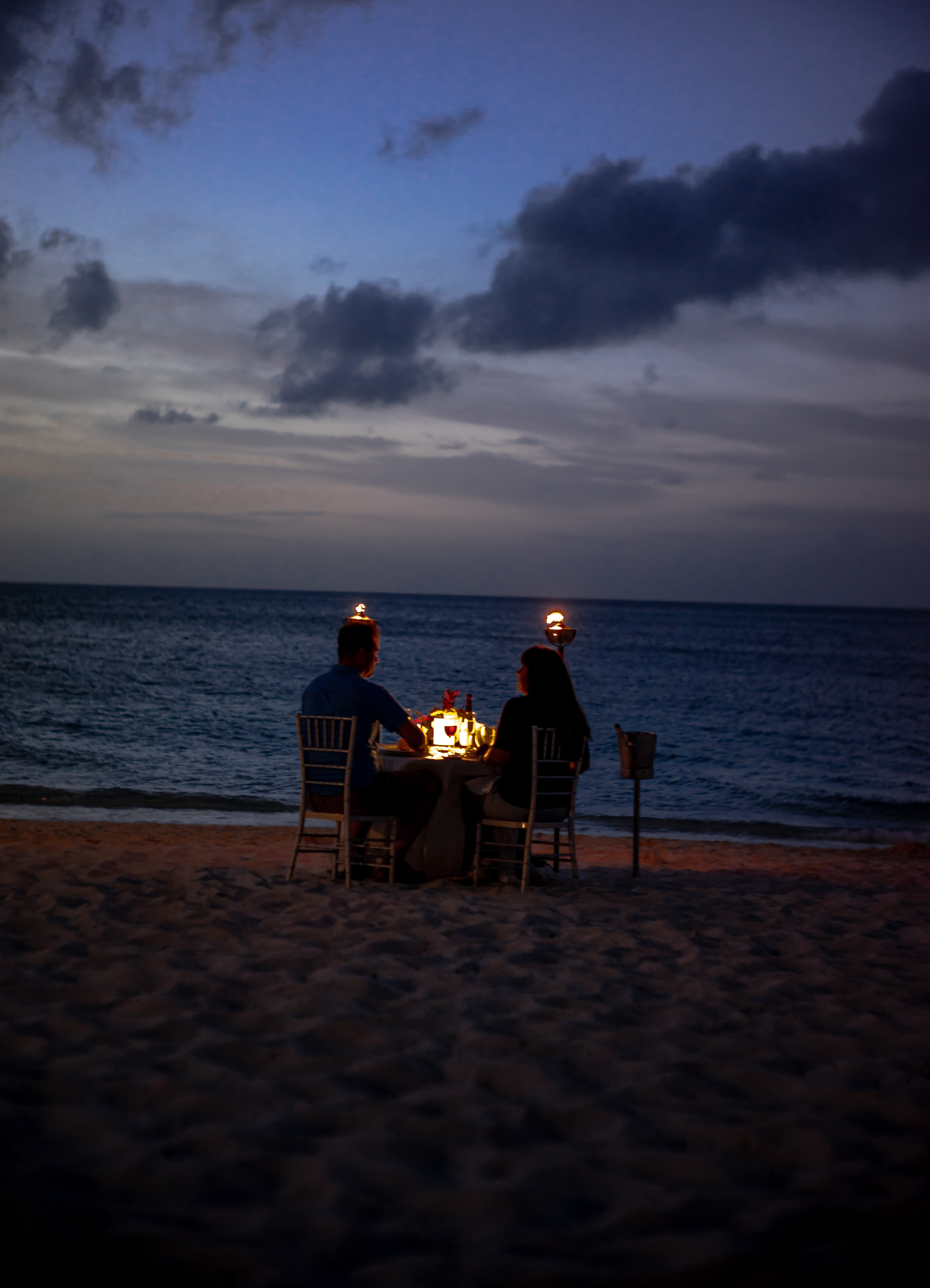 coupe on dinner date on seashore