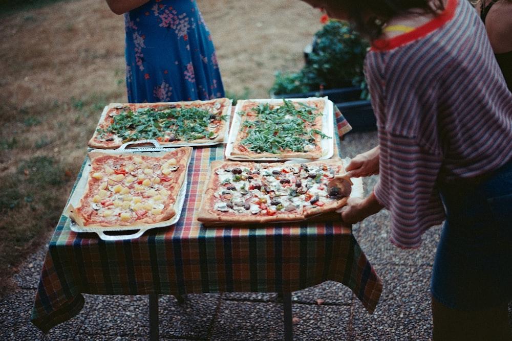 person serving pizza