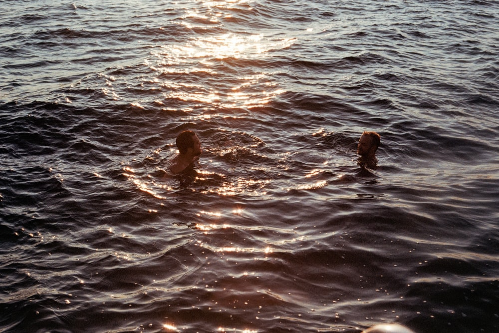 two people swimming at sea