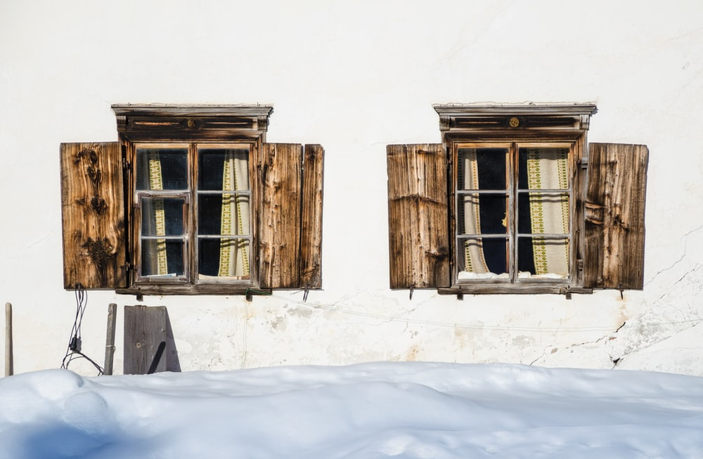 two brown wooden windows