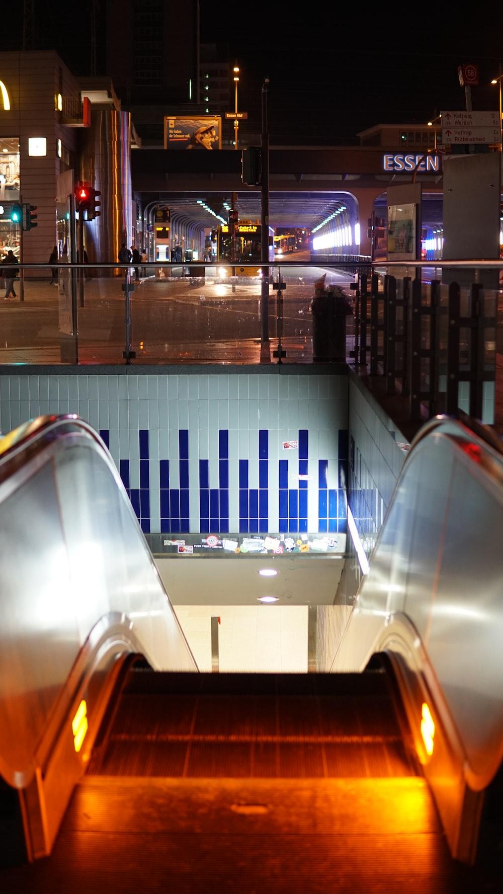gray escalator during nighttime photo