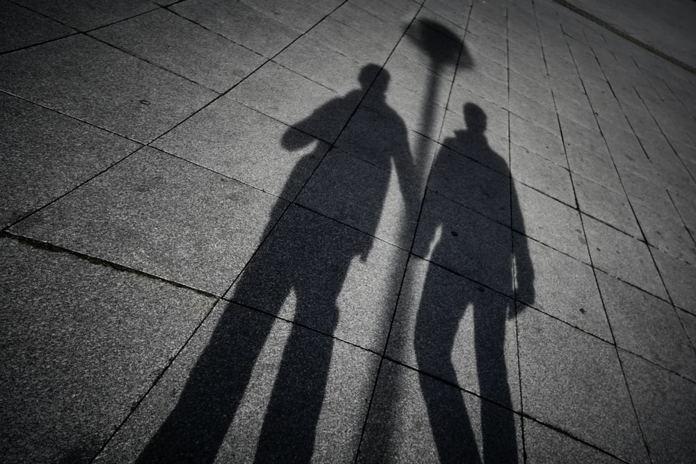 two men's shadow