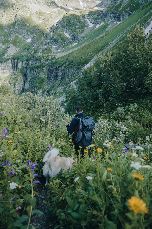 man standing on flower field