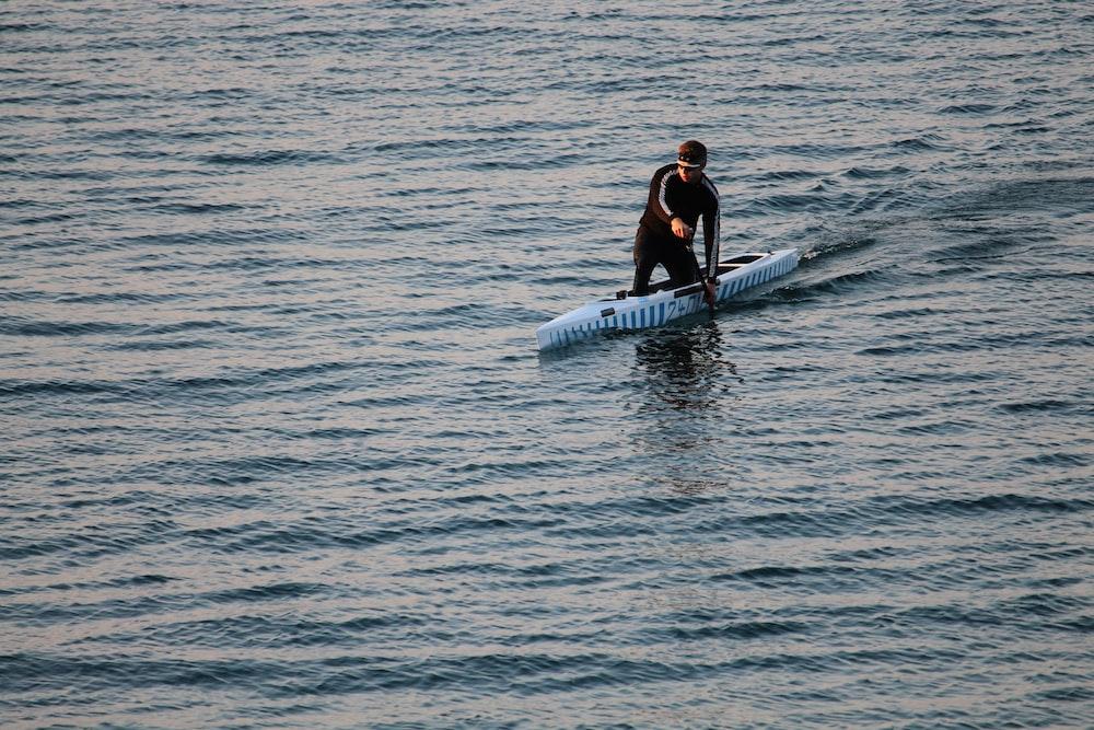 man riding on surfboard
