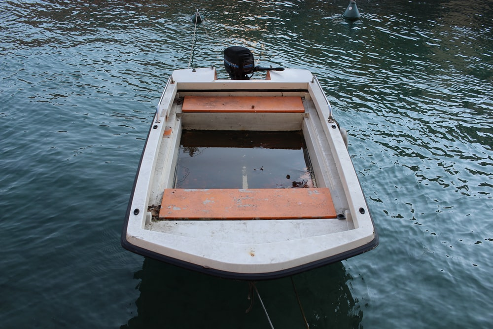 white and brown boat on water