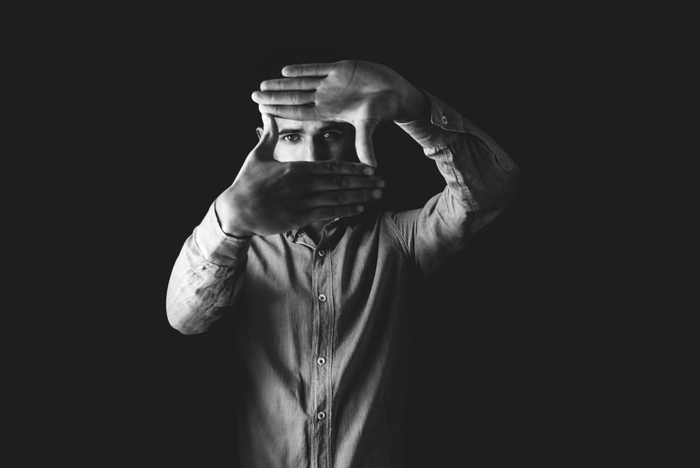 grayscale photography of man wearing dress shirt