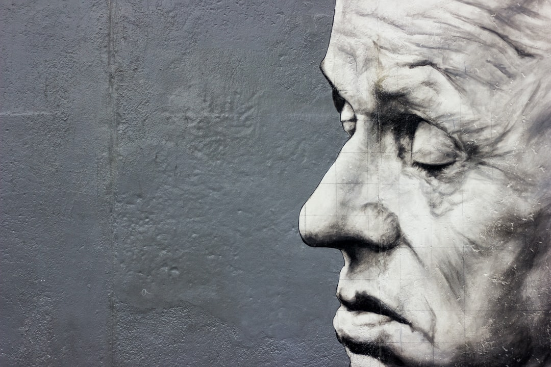 One of the many stunning and thought provoking pieces of art work on the wall at the East Side Gallery, Berlin.