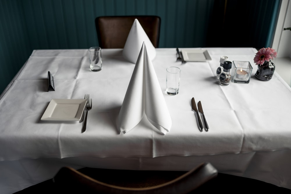 two napkins and cutleries on dining table