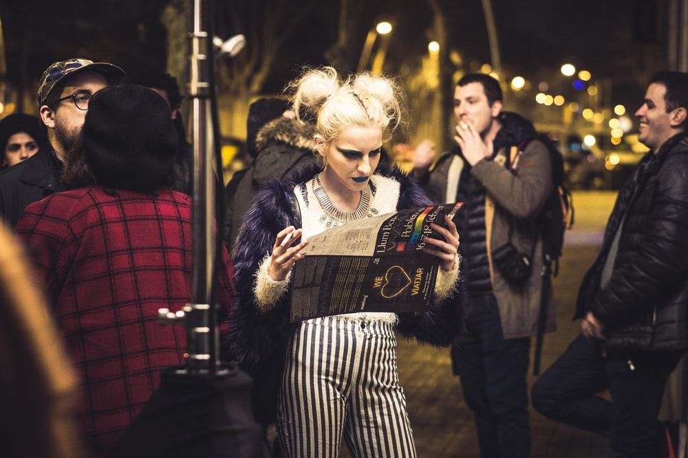 woman holding magazine