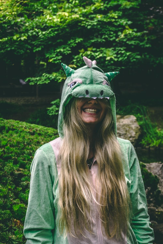 smiling woman wearing green jacket