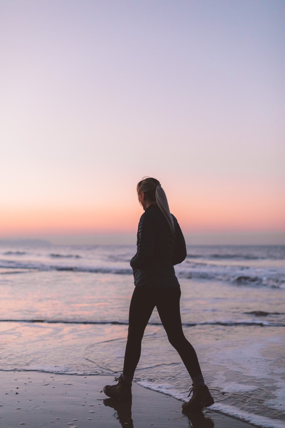 woman about to walk on shoreline