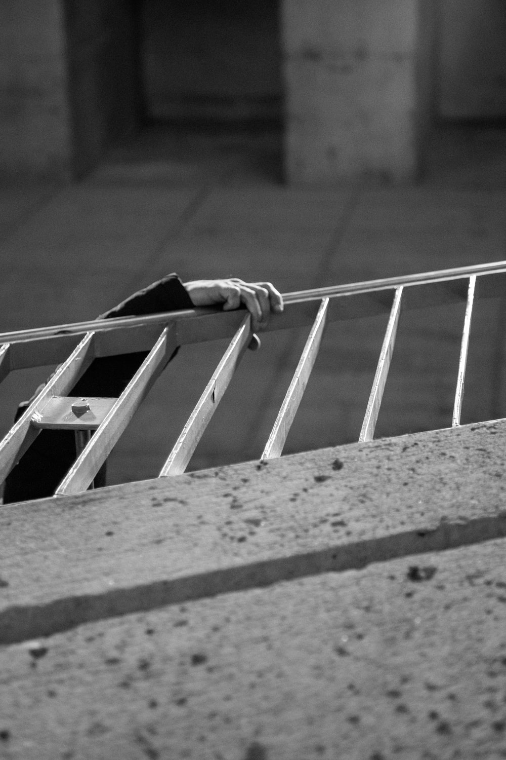 man climbing up the stairs with handrail