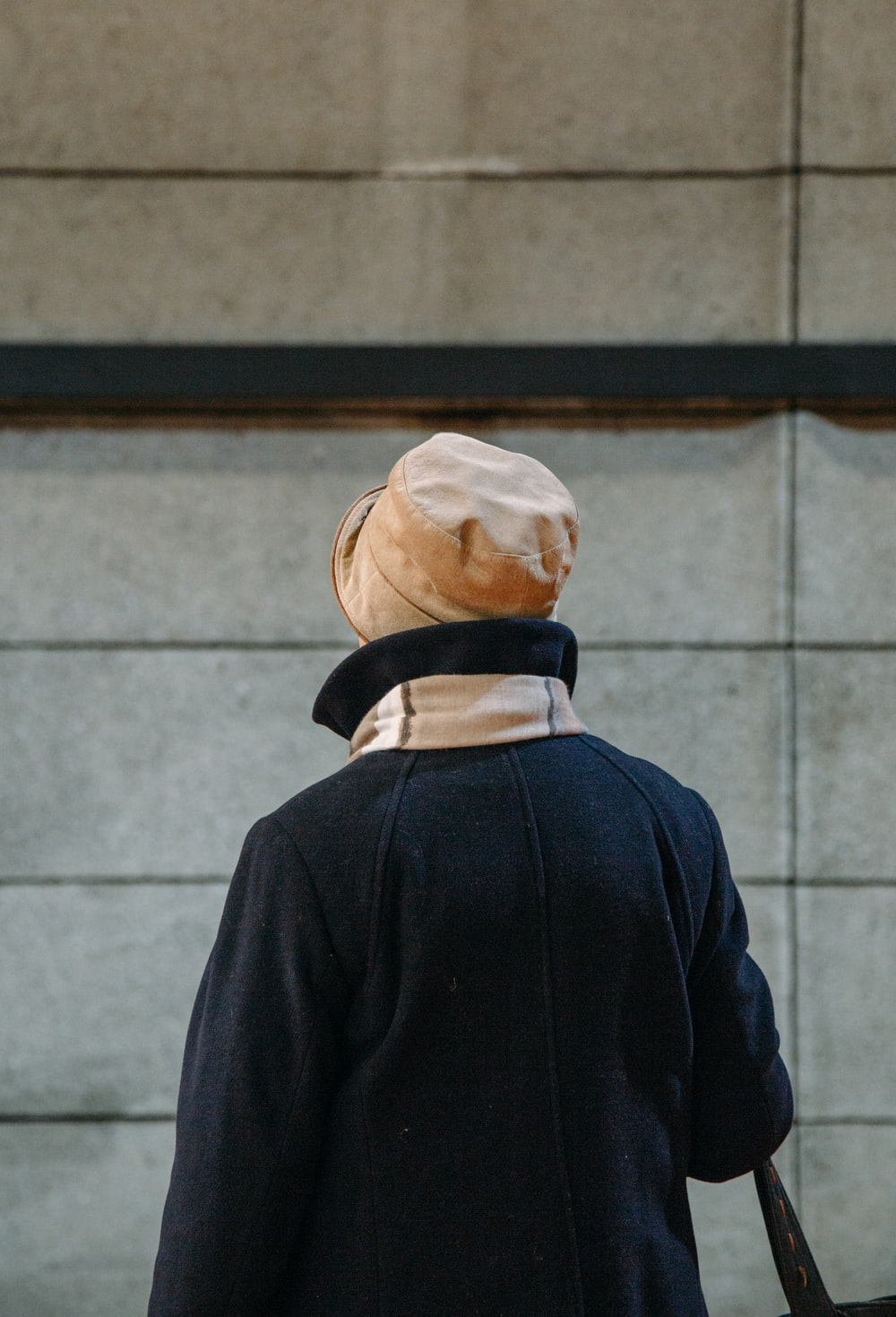 person wearing brown hat