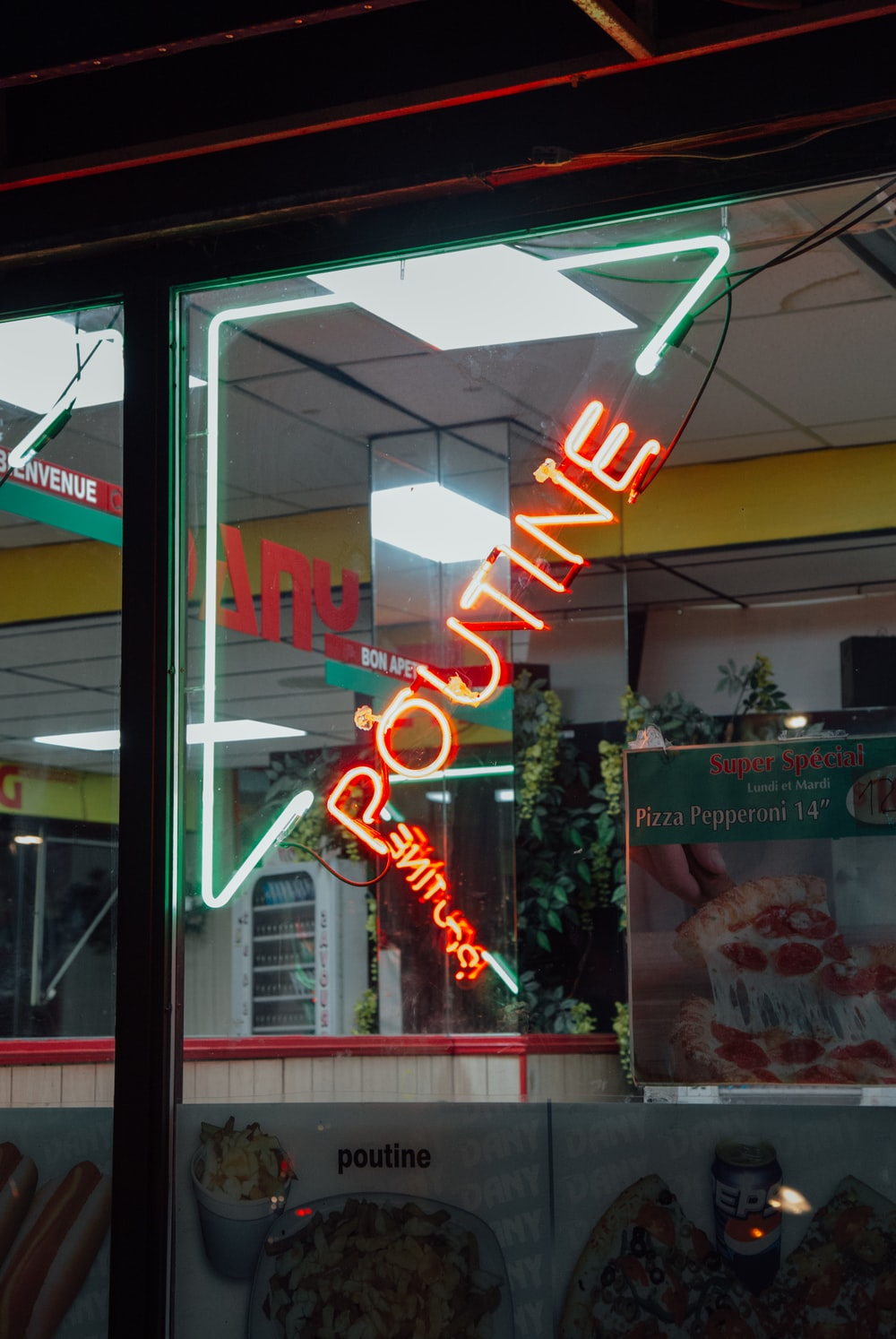 red and green Poutine neon signage