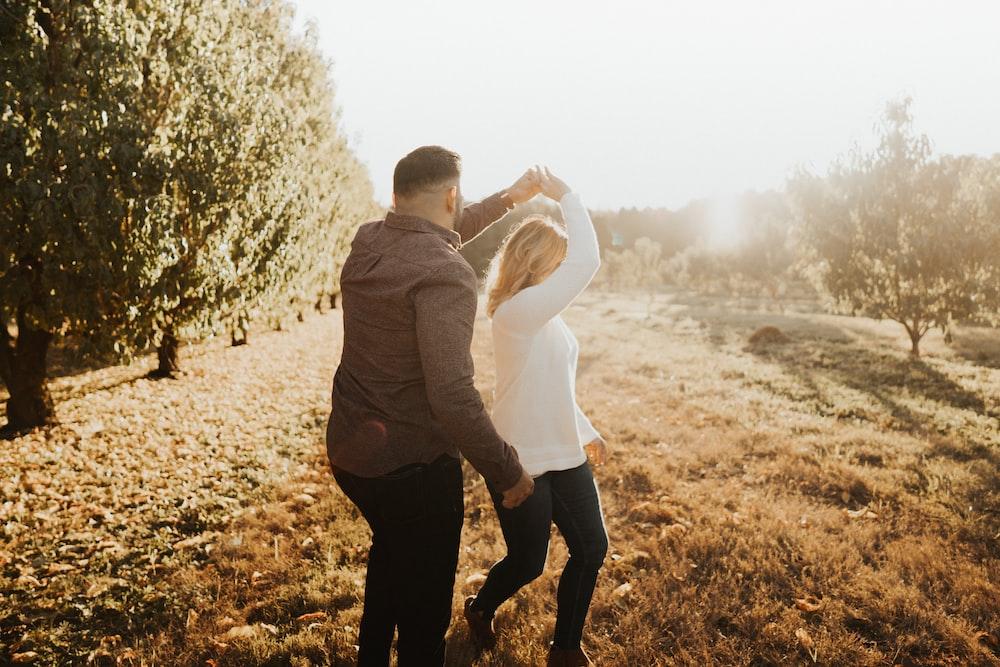 couple dancing near trees