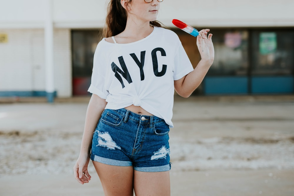 standing woman holding popsicle