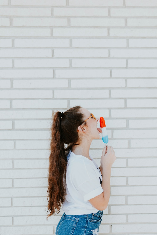 woman licking ice cream
