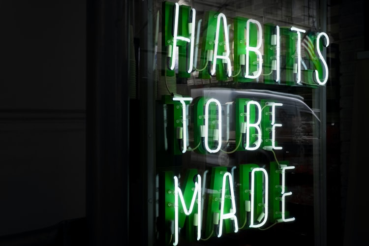 "A photo of a neon sign that says ""habits to be made"""