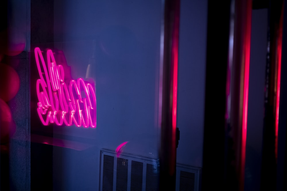 turned-on pink neon signage