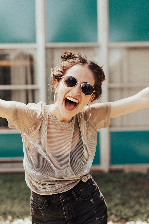 smiling woman raising hands