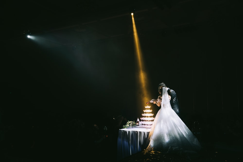 bride and groom standing beside taqble