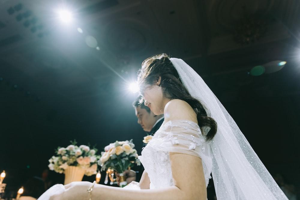 wedding couple near flower arrangements