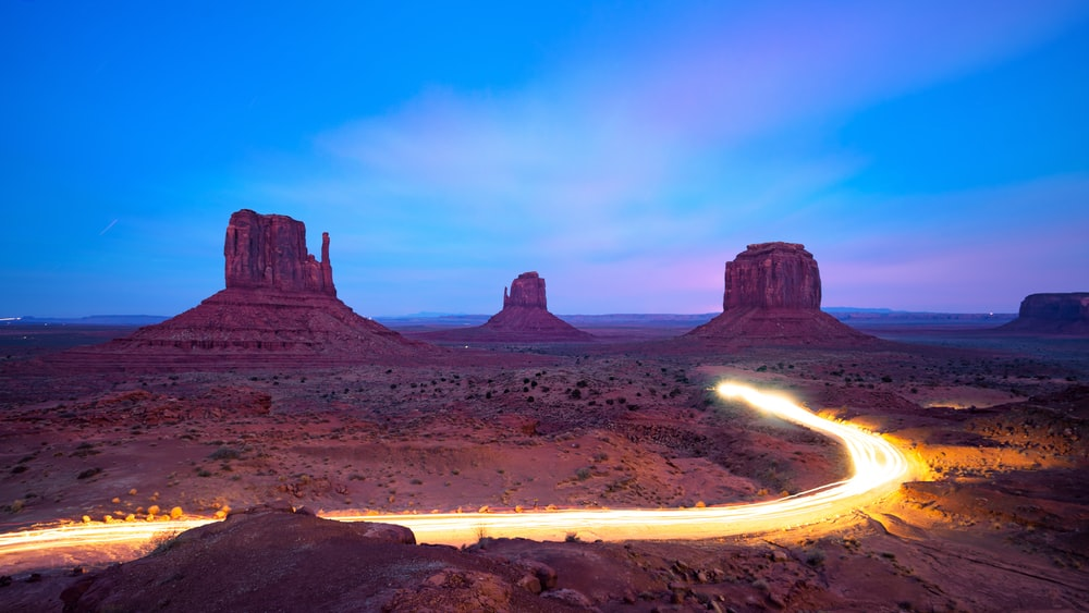 time lapse photography of Grand Canyon road during golden hour