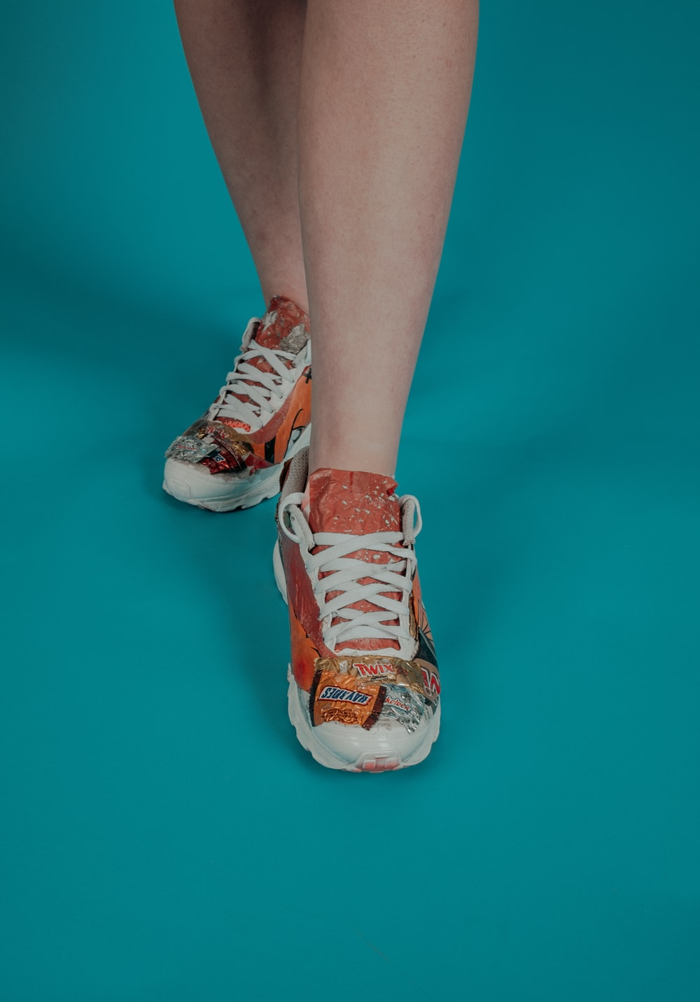 orange-and-white low-top sneakers