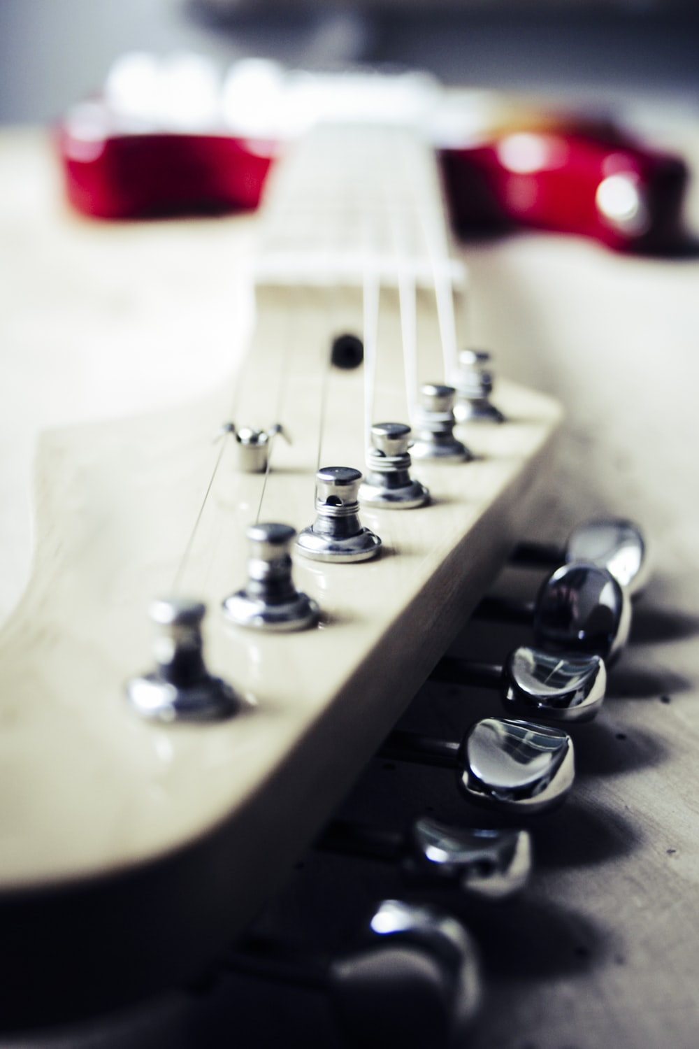 selective focus photography of electric guitar