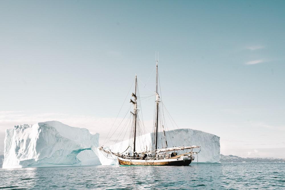 boat approaching iceberg