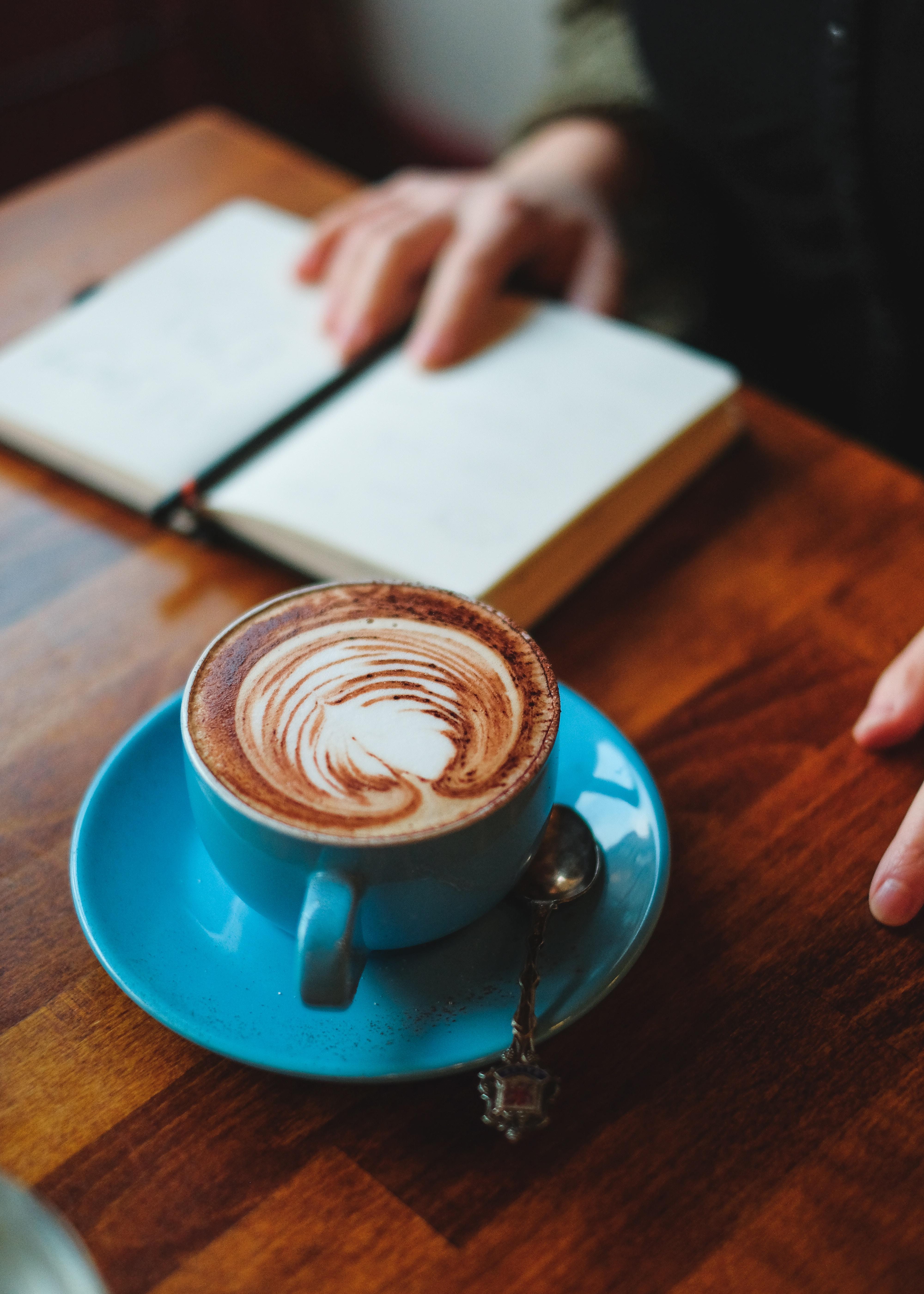 coffee in blue ceramic mug on blue ceramic plate on table