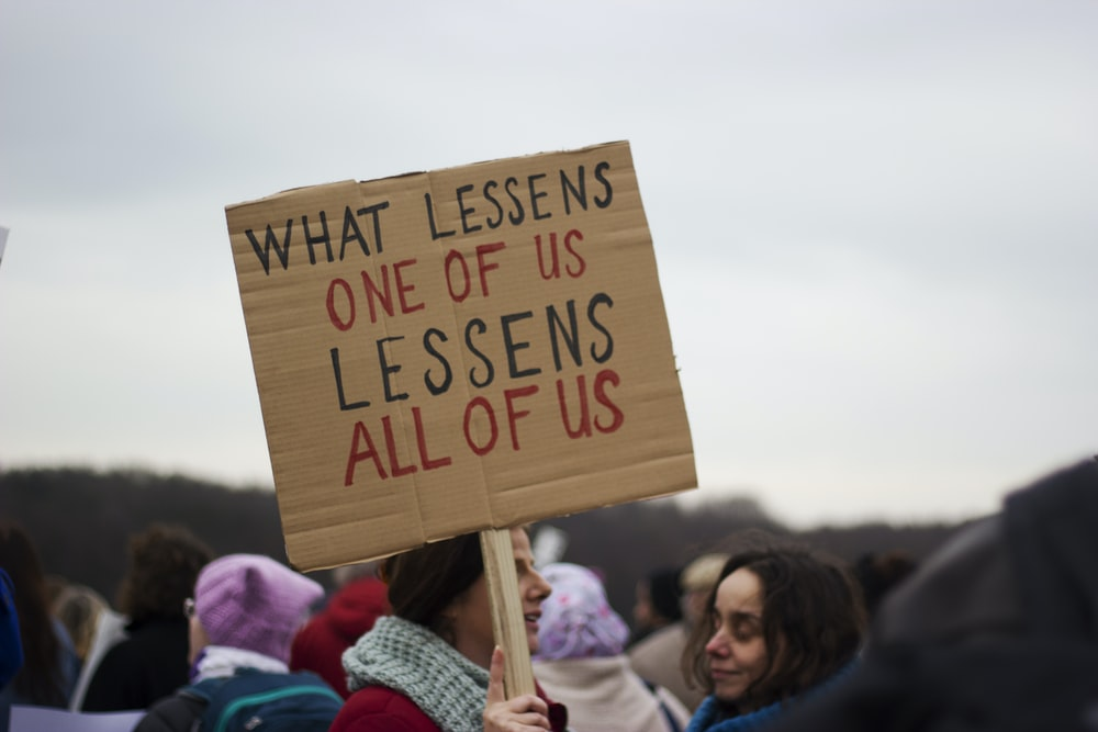 what lessens one of us lessens all of us sign